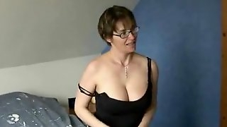 Short haired mature rubbs her nipples and finger her nasty huge cunt.