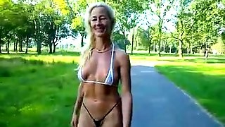 Swiss milf walks in a bikini