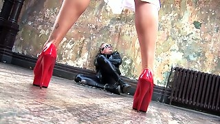 Blonde whore in red high heels and latex enjoys having rough sex