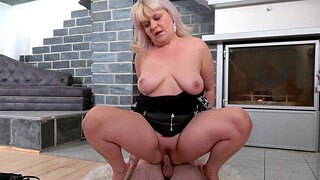 Dirty mature Monika spreads her legs to ride a younger lover