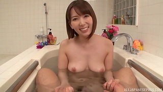 Sexy Japanese chick gives a blowjob and rides in the bathtub